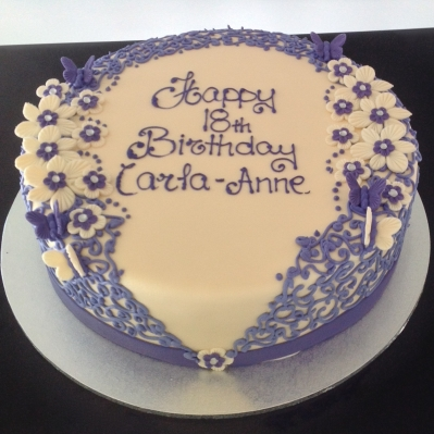 A beautiful example of our laced icing and handmade flowers and butterflies.