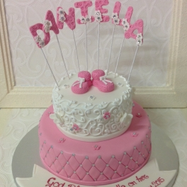 An elegant Christening cake we made for Daniella. Complete with diamante rhinestones and icing lacework.