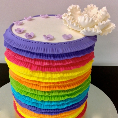 A decadent rainbow layered cake we created. All handmade ... and yes, the cake was rainbow layered too!